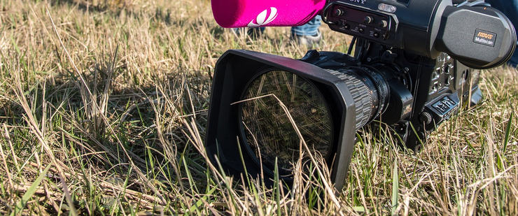 Video Camera Lying on Grass