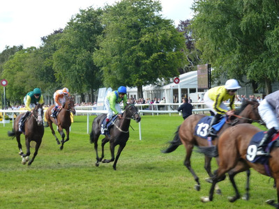 Horses Crossing the Winning Line at Newmarket's July Course