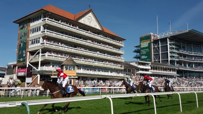 Horses Running Past the Winning Post at York Racecourse