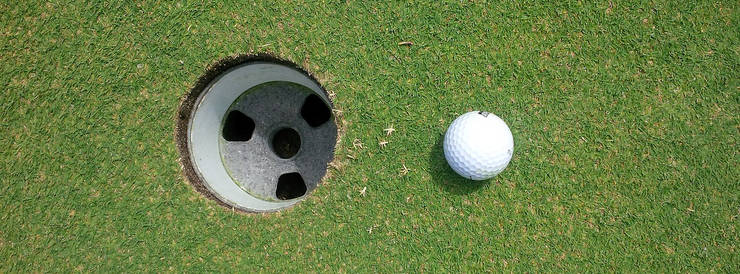 Golf Ball to the Right of a Hole