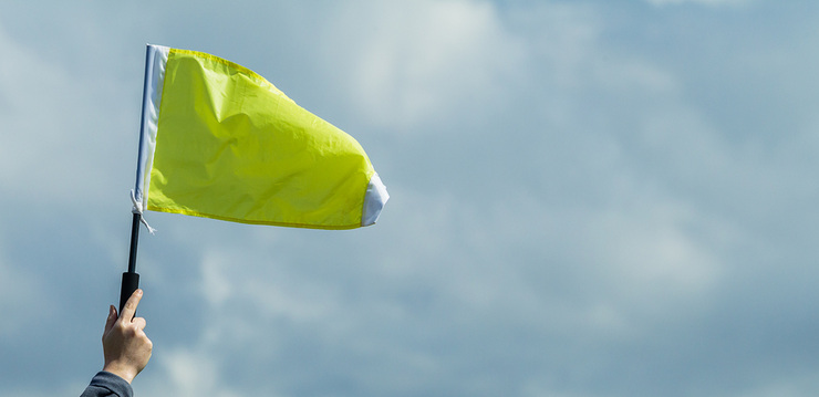 Yellow Flag Held in the Air