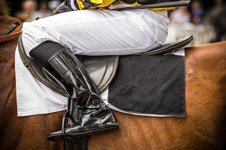 Jockey Sitting on Racehorse