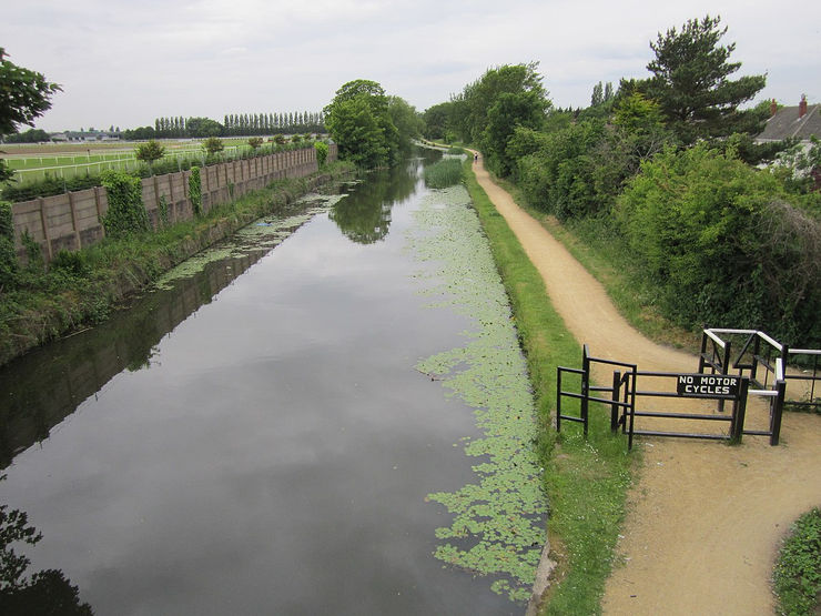 The Leeds Liverpool Canal from the Melling Road with Aintree Racecourse in the Background