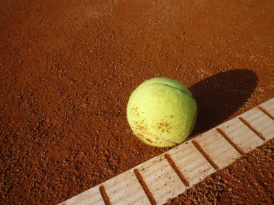 Tennis Ball on Clay Court Surface