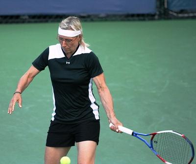 Martina Navratalova Playing Tennis Shot