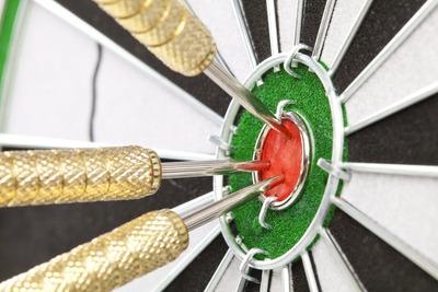 Darts in Bullseye on Dartboard