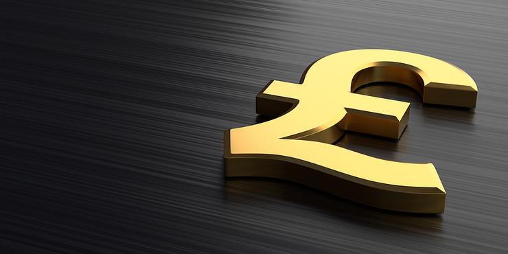 Golden Pound Sign on Black Counter