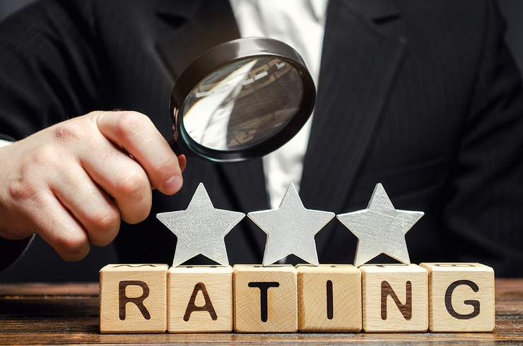 Three Star Rating Wooden Blocks and Magnifying Glass