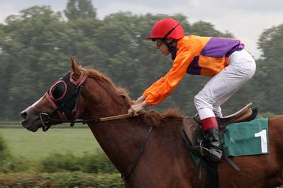 Apprentice jockey with horse