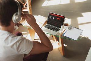 Man using laptop to bet